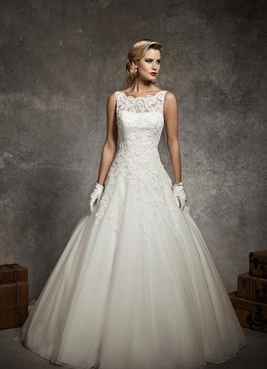 Justin Alexander 8630. Sabrina sleeveless alencon lace neckline, lace drop waist, circular cut tulle with floating appliques, v back neckline, with buttons over back zipper, chapel length train.